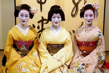 One geisha and two maiko sat in a traditional teahous
