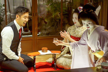 Geisha and Maiko entertain a guest in Kyoto